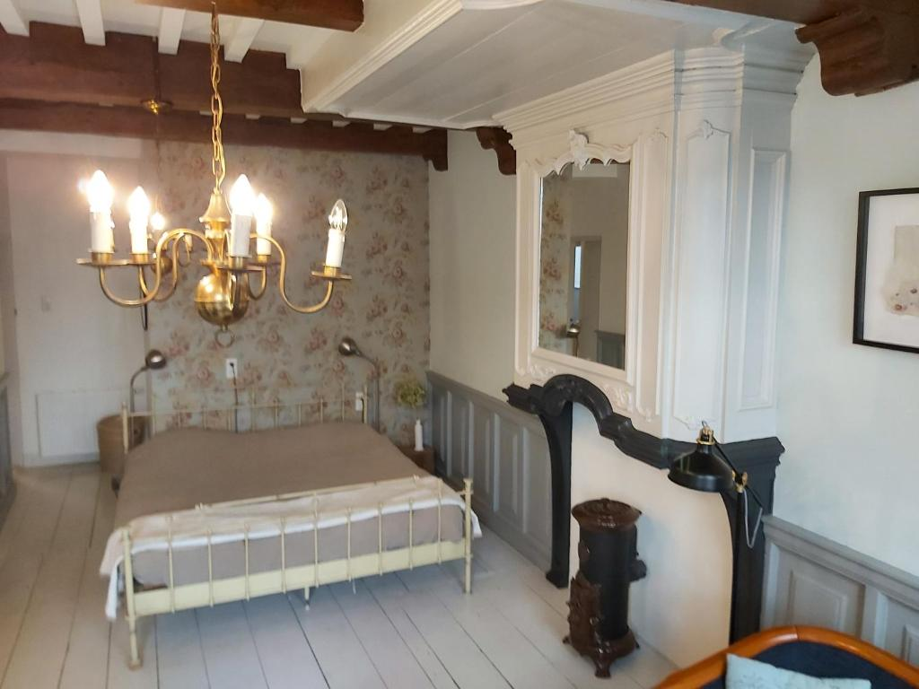 A bed or beds in a room at De olde banck