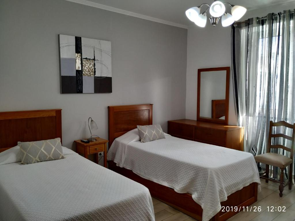 A bed or beds in a room at Hospedaria Isaias