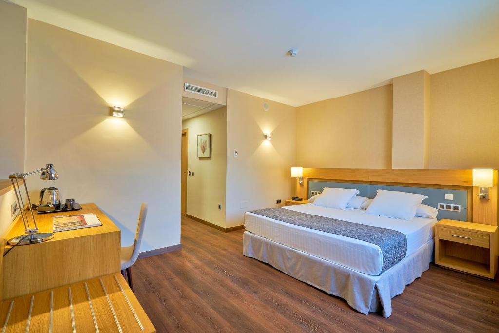 Letto o letti in una camera di Hotel Guadalmedina