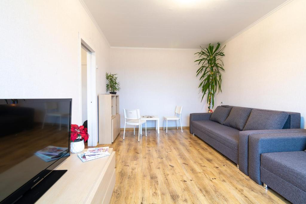 A seating area at Happy Family apartment