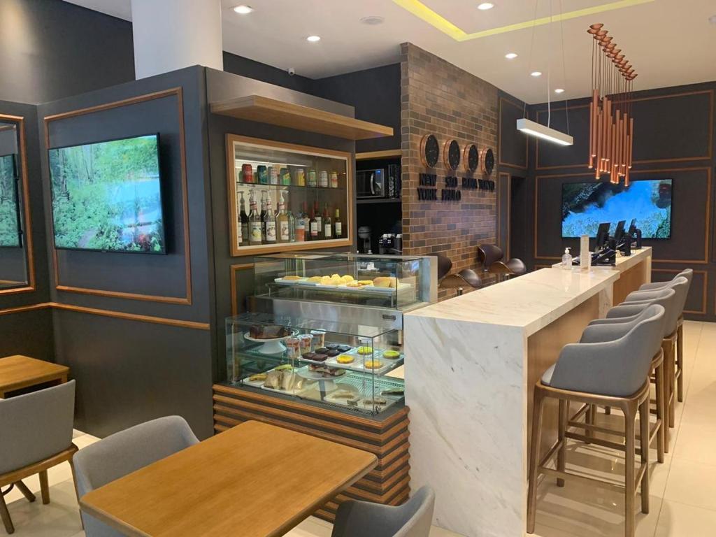 The lounge or bar area at Hotel Centro Europeu