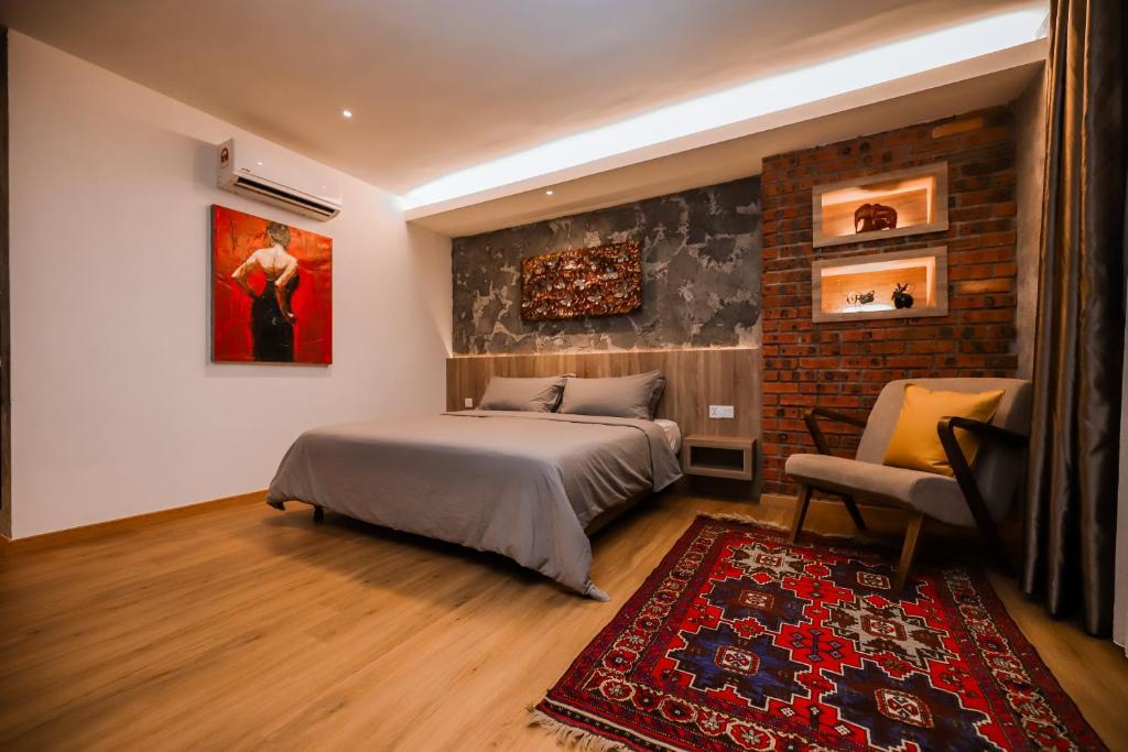 Ein Bett oder Betten in einem Zimmer der Unterkunft Arch Studio Cenang