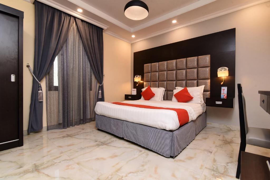 Cama ou camas em um quarto em OYO 356 Durra Taraf Residential