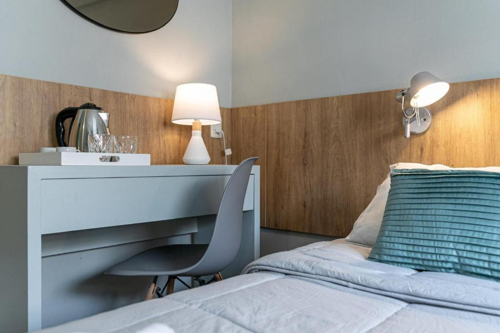 Cama ou camas em um quarto em Hotel Urban Express