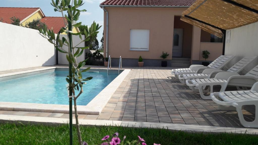 The swimming pool at or close to Holiday Home Luka