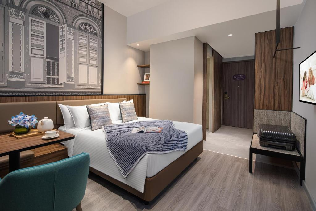 A bed or beds in a room at Citadines Rochor (SG Clean)