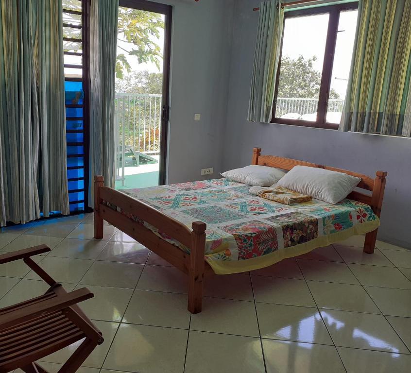 Cama ou camas em um quarto em TAHITI - Chambre Hautia