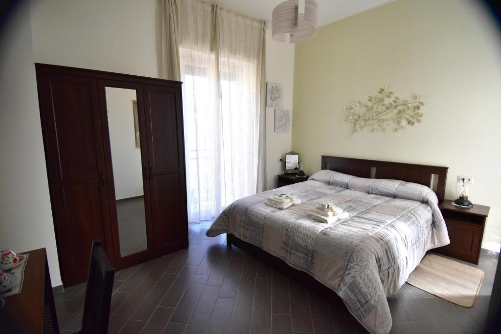 A bed or beds in a room at B&B Lambda