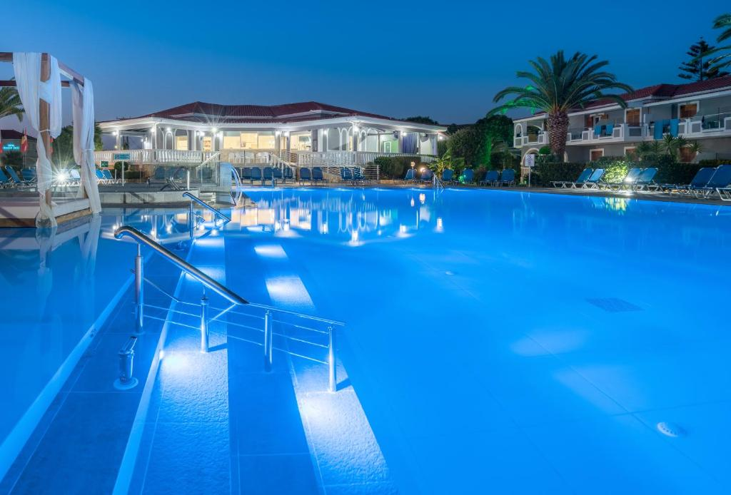 The swimming pool at or near Golden Sun Hotel