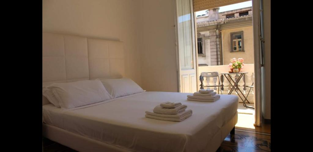 A bed or beds in a room at Cagliari d'Amare Via Roma
