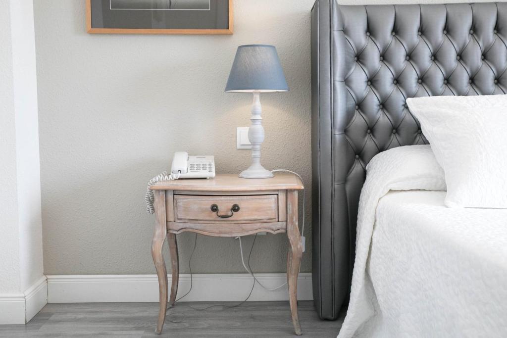 Cama o camas de una habitación en Hotel Jávea