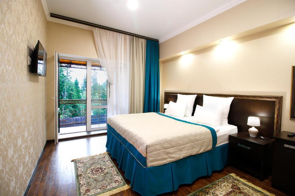 Кровать или кровати в номере Отель Таурух