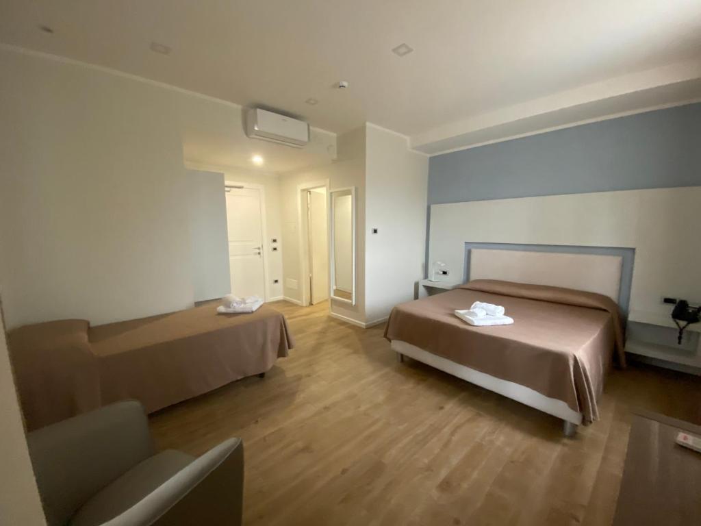 Letto o letti in una camera di La Porta del Sole Hotel & Village