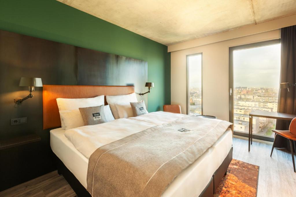 Een bed of bedden in een kamer bij the niu Fender