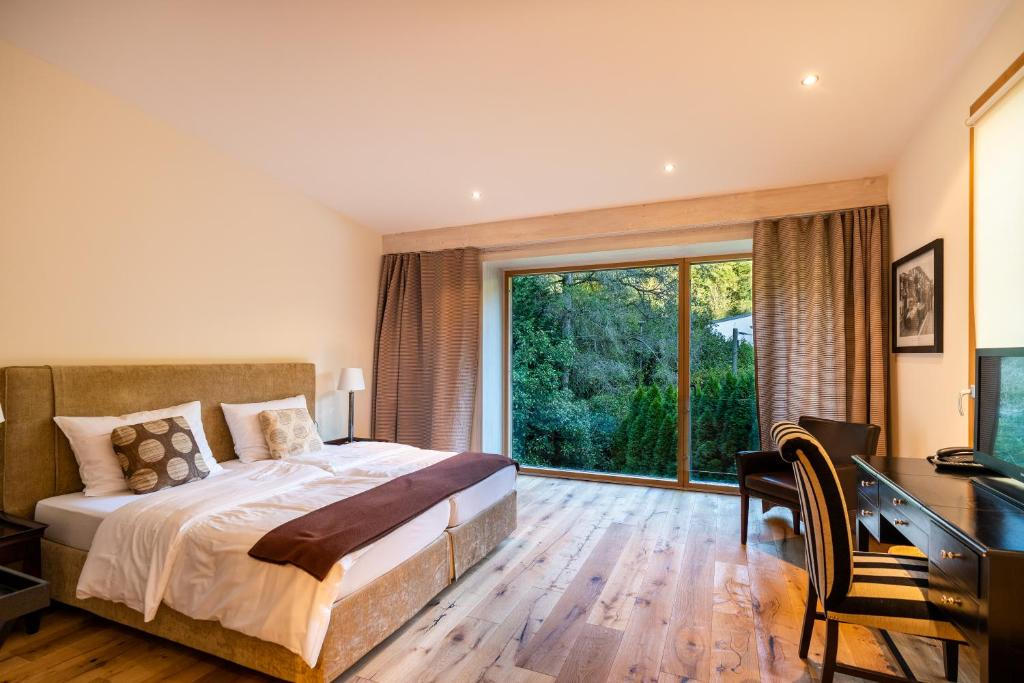 Ein Bett oder Betten in einem Zimmer der Unterkunft Villa Waldesruh