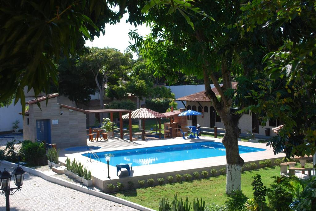 The swimming pool at or near Hotel Rusticos