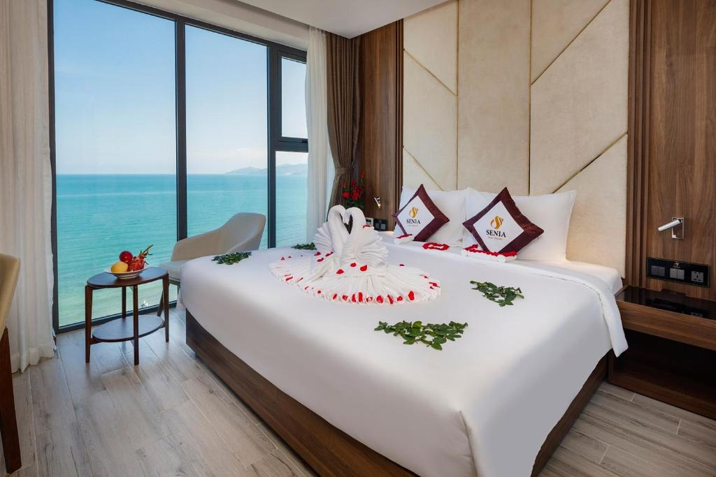 A bed or beds in a room at Senia Hotel Nha Trang