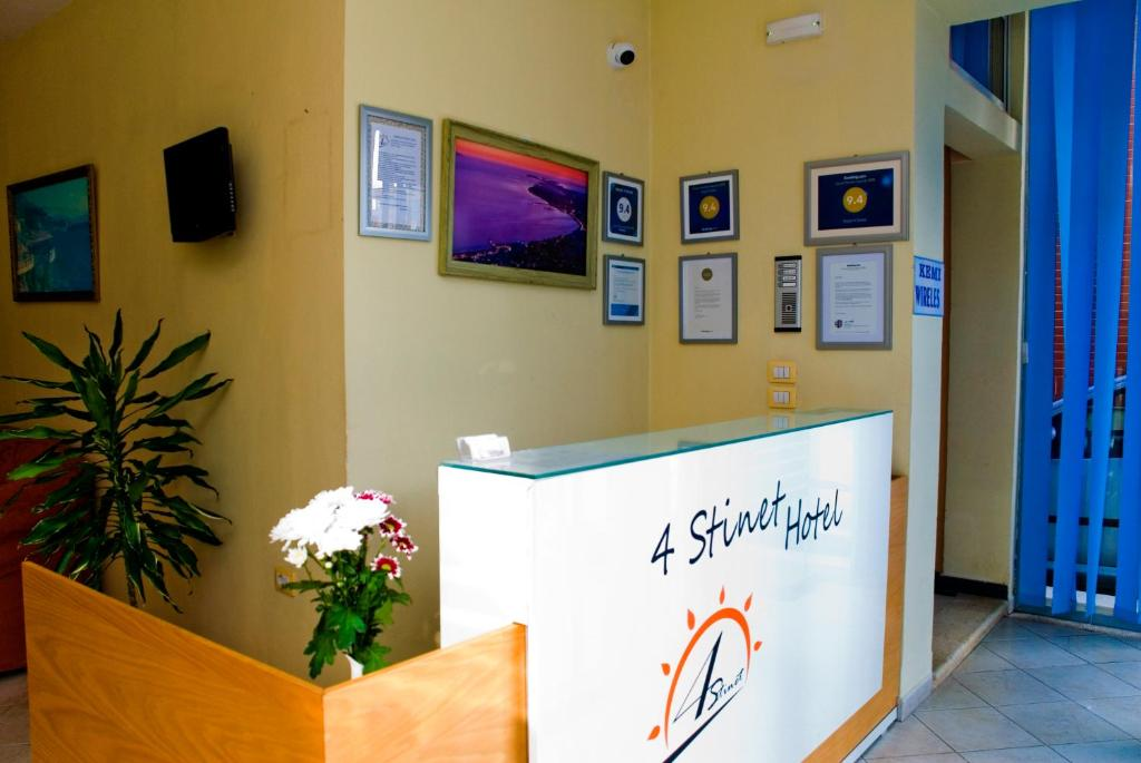 The lobby or reception area at Hotel 4 Stinet