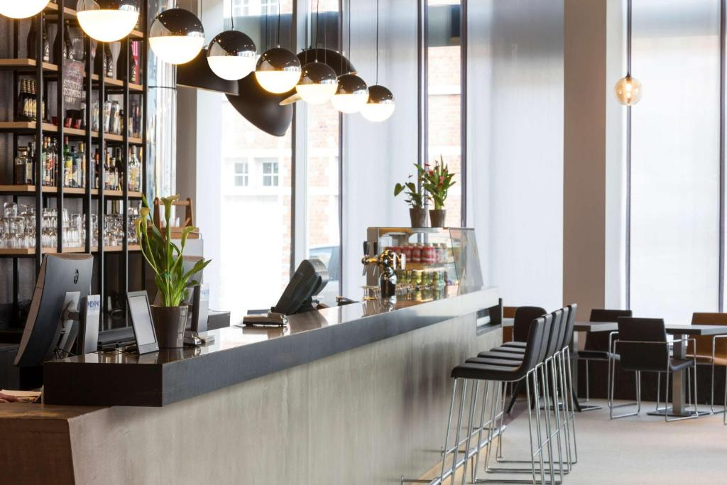 A restaurant or other place to eat at Park Inn by Radisson Leuven