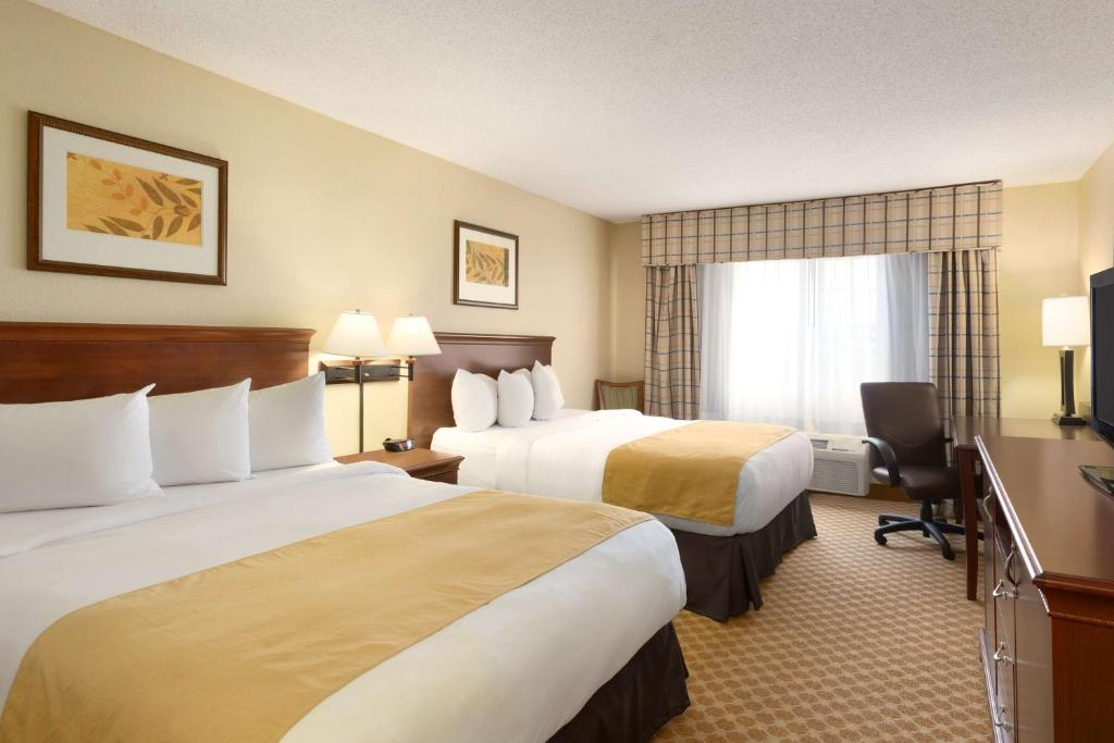 A bed or beds in a room at Country Inn & Suites By Carlson - Rochester