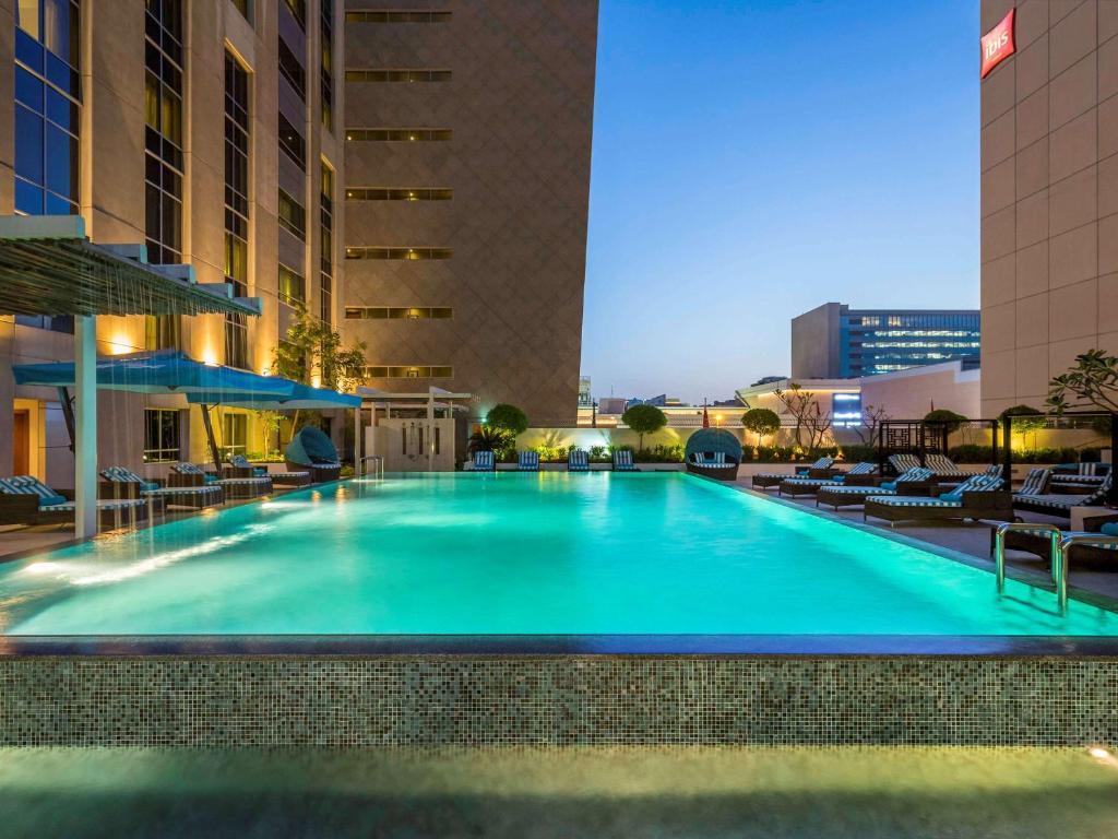 The swimming pool at or near Novotel Deira City Centre