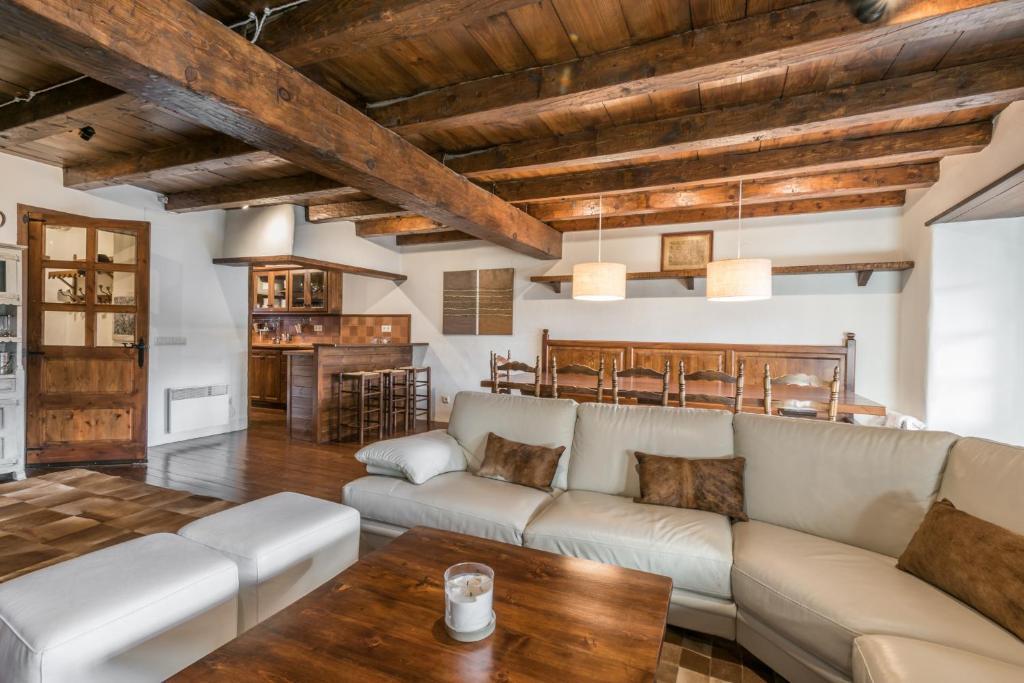 A seating area at Casa Pomarin by Totiaran