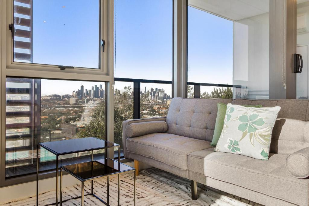 A seating area at Breathtaking unit with city and racecourse views