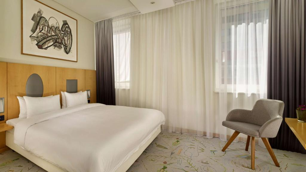 A bed or beds in a room at Park Plaza Berlin Kudamm