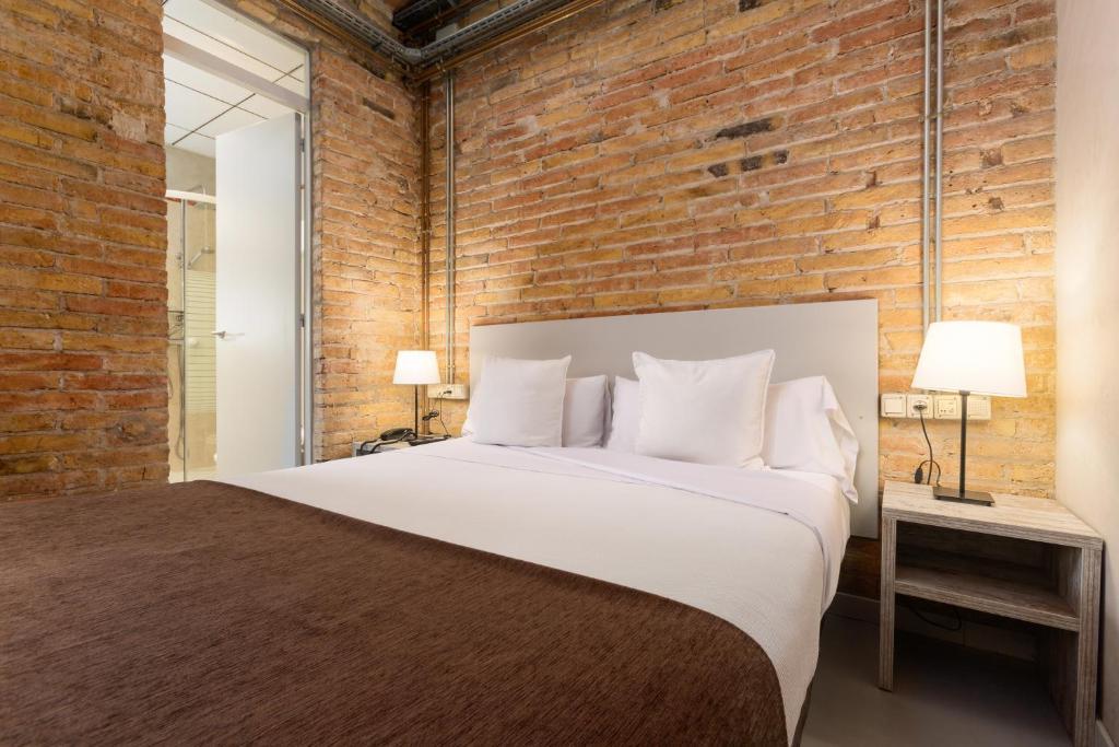 Cama o camas de una habitación en Apartamentos DV
