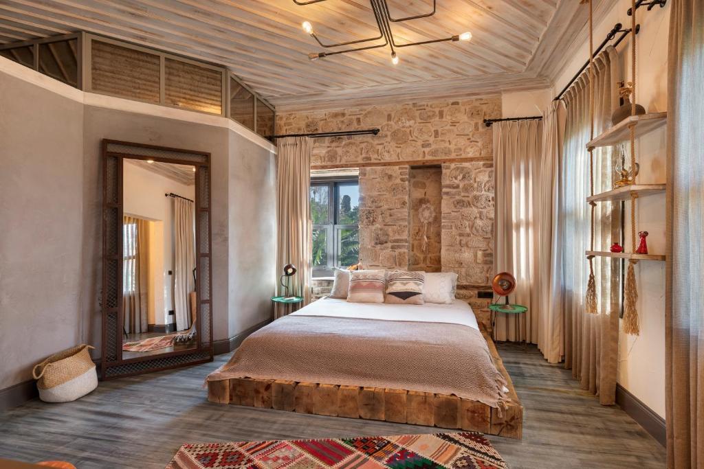 Кровать или кровати в номере Casa Sur Antalya