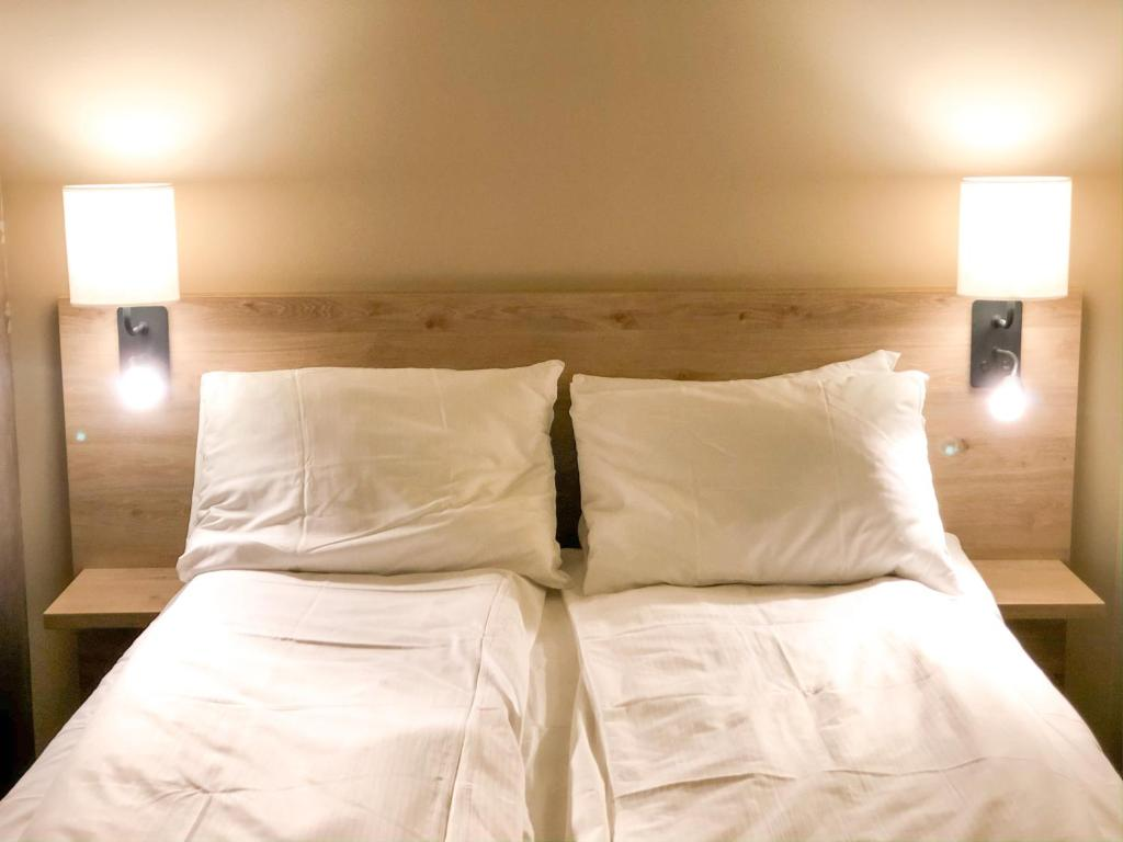 Cama o camas de una habitación en Gaustad Hotel