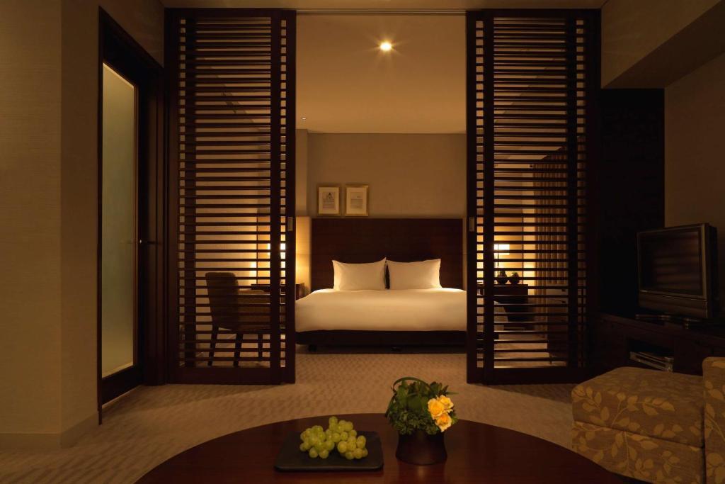 A bed or beds in a room at Hyatt Regency Tokyo