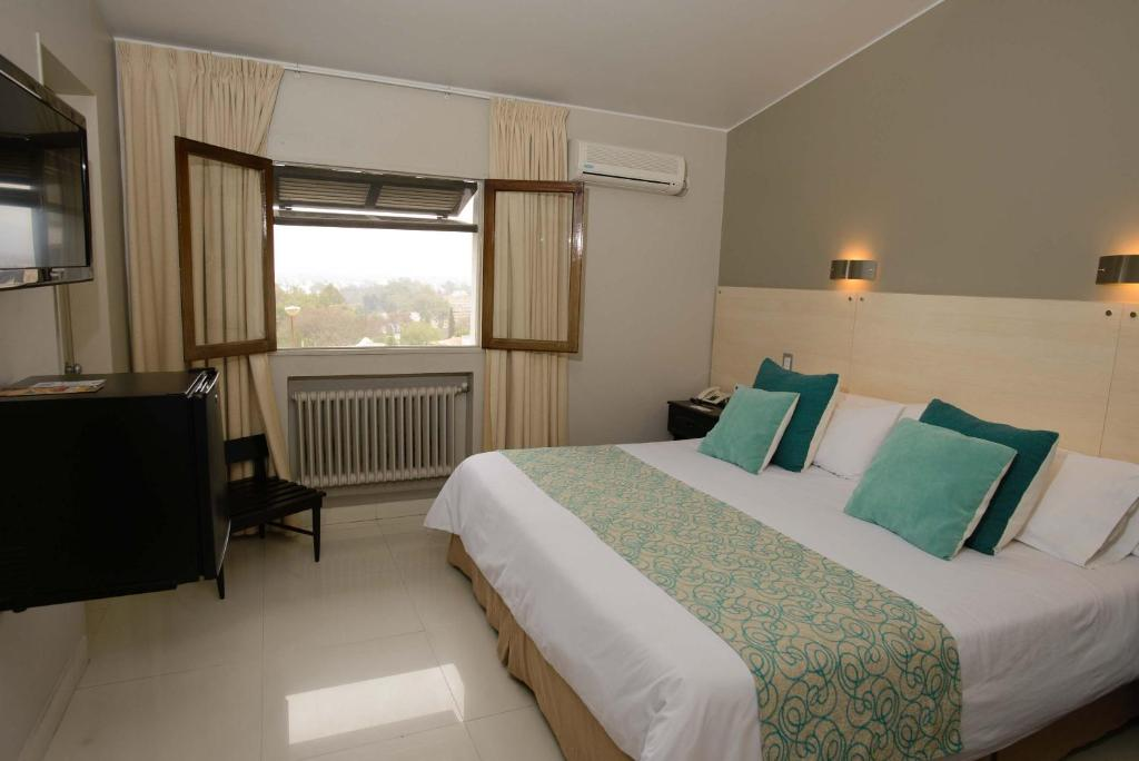 A bed or beds in a room at Portezuelo Hotel