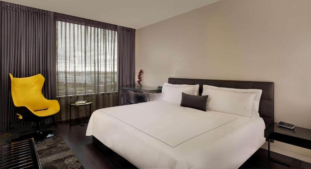 A bed or beds in a room at Park Plaza London, Park Royal