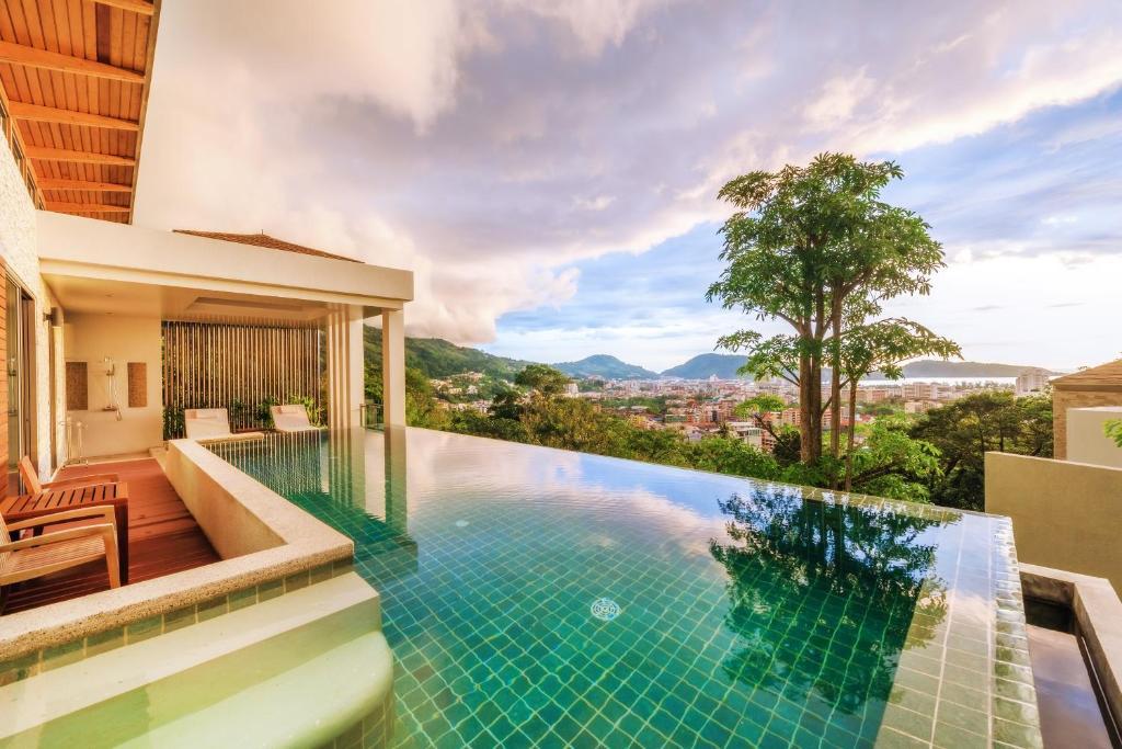 The swimming pool at or near Wyndham Sea Pearl Resort, Phuket - SHA Plus