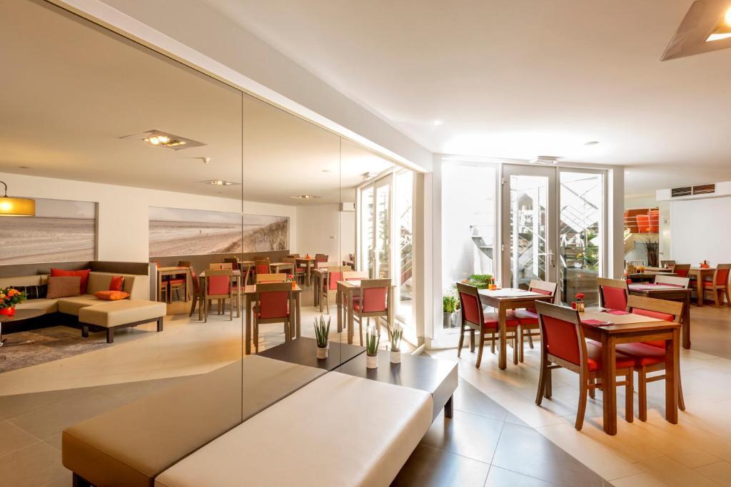 Ein Restaurant oder anderes Speiselokal in der Unterkunft Hotel Adagio