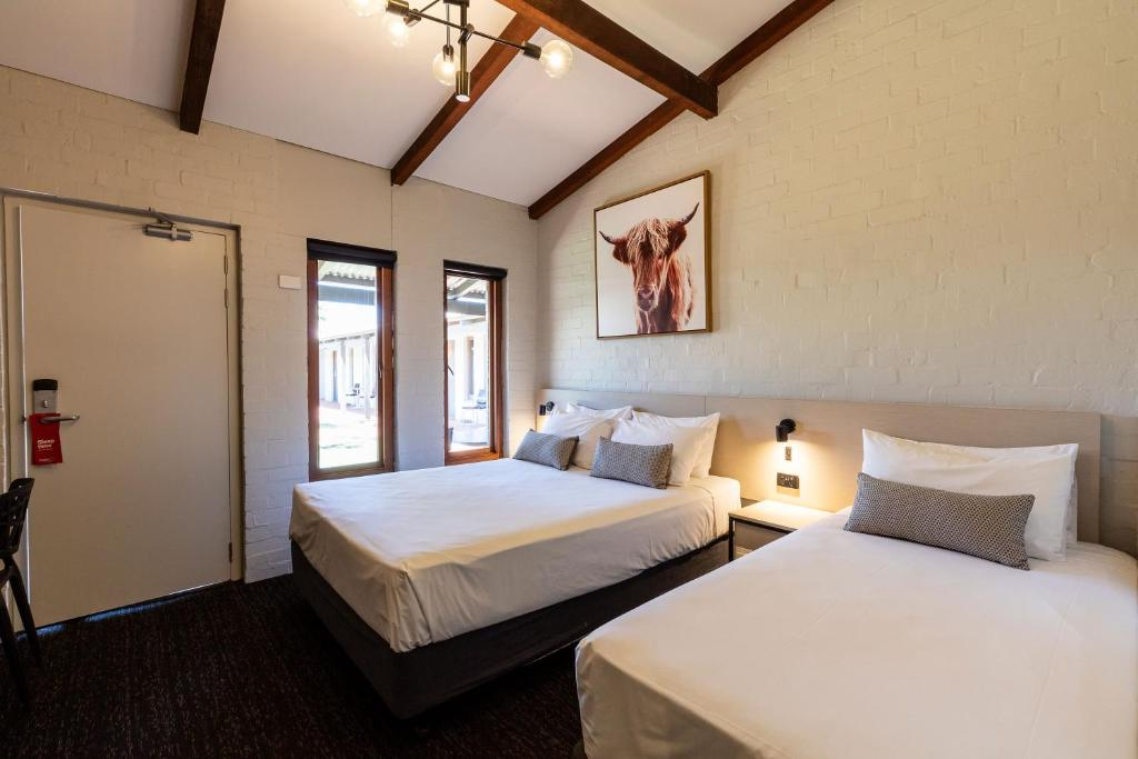 A bed or beds in a room at Nightcap at Wintersun Hotel