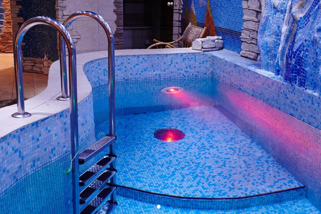 The swimming pool at or near ЯР Hotel&SPA