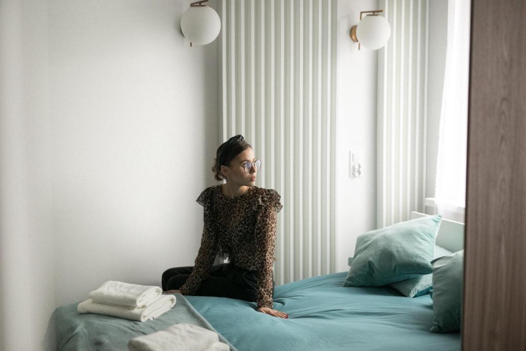 Łóżko lub łóżka w pokoju w obiekcie Apartament Różana