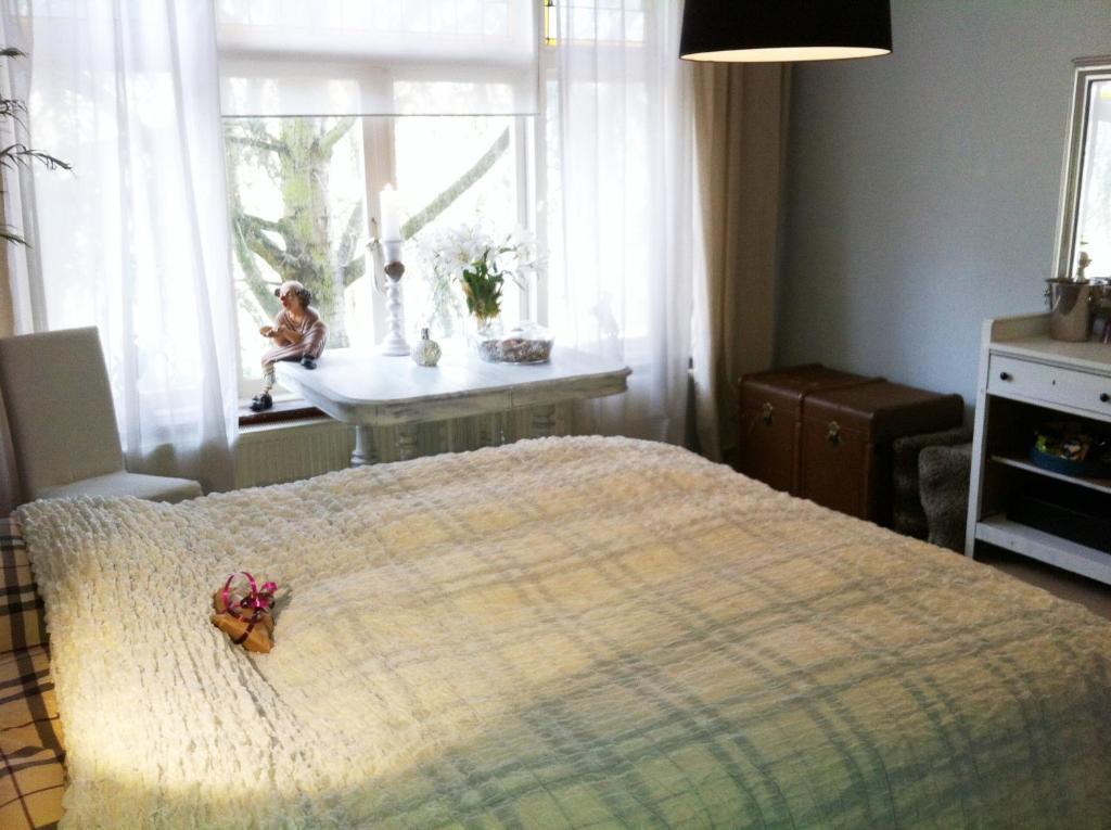 Een bed of bedden in een kamer bij B&B BeautySleep