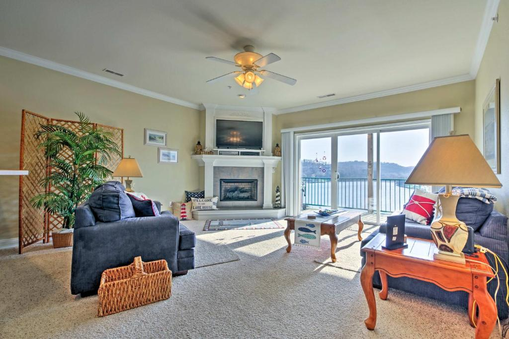 A seating area at Condo on Lake of the Ozarks with Boat Slip and Pool!