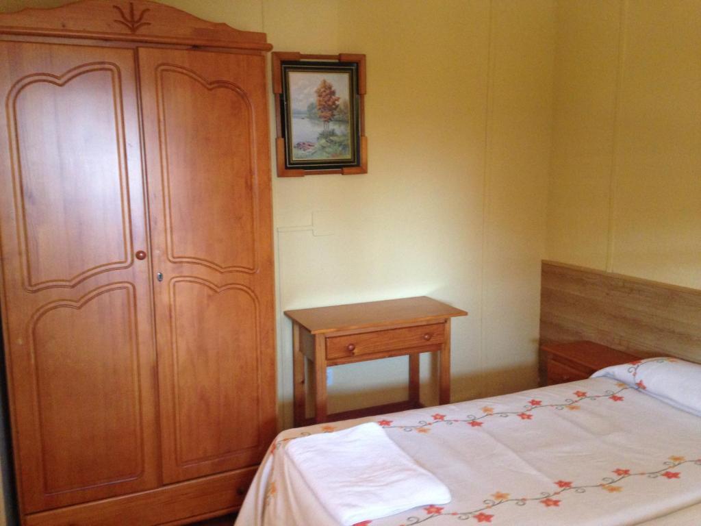Cama o camas de una habitación en Camping Cubillas