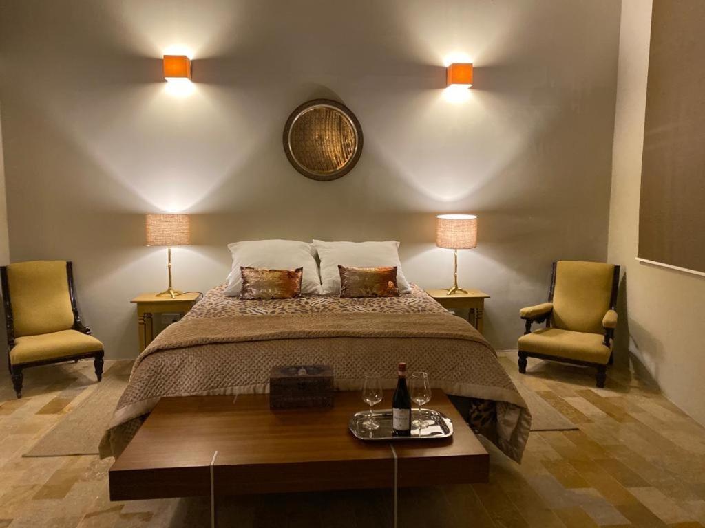 Un ou plusieurs lits dans un hébergement de l'établissement Sliema La Loggia DeLuxe Suites