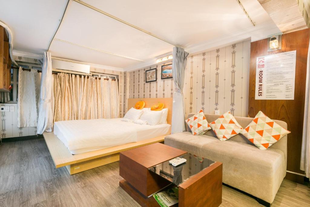Un ou plusieurs lits dans un hébergement de l'établissement OYO 708 The Cozi House - Homestay