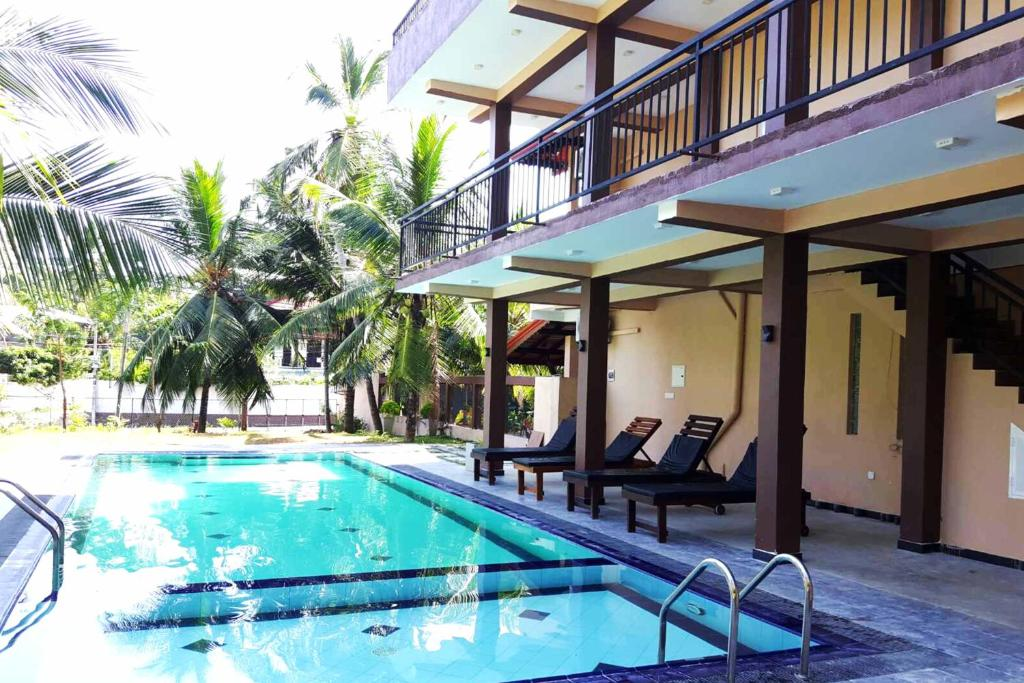 The swimming pool at or near Grand Residence
