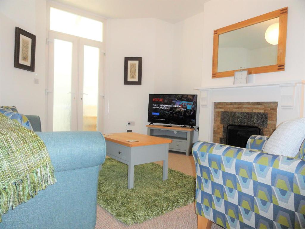A seating area at Homely and well appointed Priory Apartment by Cliftonvalley Apartments