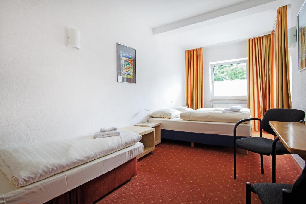 A bed or beds in a room at Baltic Hotel Lübeck