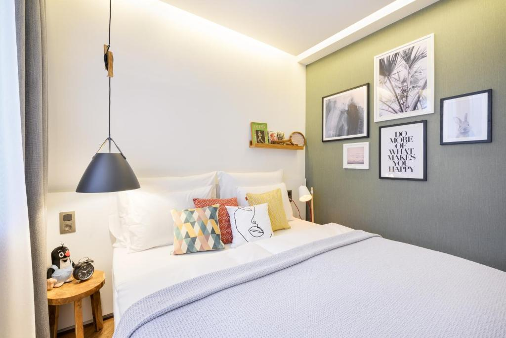A bed or beds in a room at Mosaic House Design Hotel