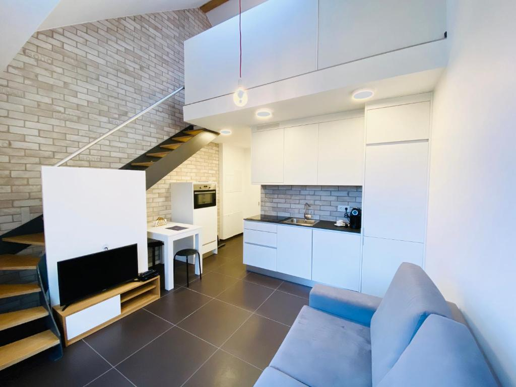 A kitchen or kitchenette at WakeUp Esch-City