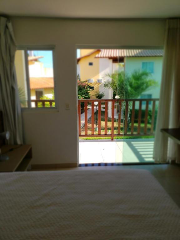 A balcony or terrace at Pousada Villa das Palmeiras